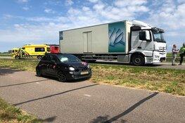 Auto tegen vrachtwagen: N250 afgesloten